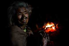 Apatani lady warming near the fire. Ziro, Arunachal Pradesh. NE India (NeSlaB ф.) Tags: poverty travel portrait woman india look tattoo lady canon nose fire photo eyes lowlight women fireplace indian traditional culture photojournalism plate tribal clothes tradition tribe ethnic northeast longhouse enlarged reportage nationalgeographic ethnography ethnology neindia arunachalpradesh ziro ethnies apatani noseplugs lowersubansiri neslab davidecomelli