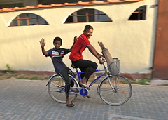 Off to cricket practice (jeremyhughes) Tags: street boys bike bicycle youth children cycling nikon fort transport wideangle cricket explore riding srilanka nikkor galle bats riders twoup cricketbat gallefort bluebike d700 offtopractice 24mmf14g