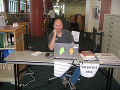 David in our temporary referance desk (Clearwater Public Library System Photos) Tags: cpls clearwaterpubliclibrarysystem clearwaterpubliclibrary clearwater clearwatermainlibrary mainlibrary main mainlibraryconstruction construction reference demolition magazines desk informationdesk 2013