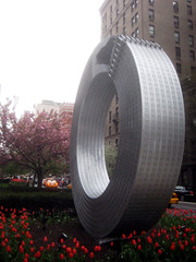 Silver Building Sculpture Attacking Itself Art 8518 (Brechtbug) Tags: park street nyc urban sculpture building tower art public by architecture silver circle manhattan no malls bent avenue alexandre median rolling itself attacking bending limits 54th 67th 2013 arrechea