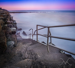 Stairs To Surf Heaven Panorama at sunset (Michael Ver Sprill) Tags: longexposure sunset sky panorama beach mike stairs michael newjersey nikon rocks waves nj rail stairway shore deal handrail jerseyshore stitched mv d800 lightroom flickraward 10stopbwfilter versprill photographyforrecreation mikeversprillcom hurricanesandydamage 28mm18glens