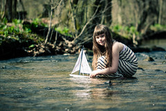 Sailing in a creek (Kilkennycat) Tags: water girl sailboat creek canon children toy boat model child sail 500d kilkennycat t1i ryanconners 100mm28l
