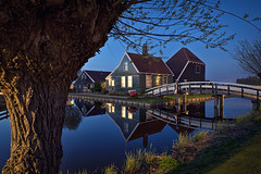 Zaanse Schans (Allard One) Tags: old longexposure bridge urban house holland heritage history water netherlands dutch architecture vintage reflections landscape canal wooden nikon dusk branches scenic may nederland clarity peaceful calm illuminated historic f16 willow le bluehour 24mm mei twigs iconic idyllic neighbourhood touristattraction zaanseschans noordholland 120s zaandam naturalframe municipality zaanstreek paintlike zaandijk zaanstad northholland pittoresque olddutch knotwilg windstil pollardwillow dutchtreat 2013 museumarea pictoresque d700 nikond700 nikkor2470mmf28 nikonfx allardone panoramafotografico allard1 zaanshuisje mygearandme allardschagercom