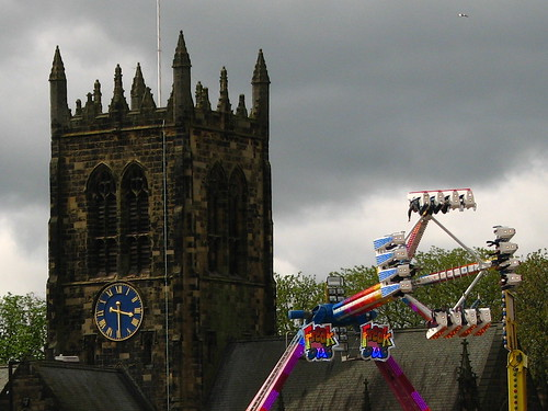 Funfair ride and All Saints church