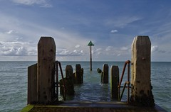 End of the Jetty (Sundornvic) Tags: aberystwyth jetty sea water wood posts clouds sun sky blue white