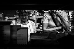 261/366 - See The Bigger Picture (www.biggerpicture.cards) - Natrlicher Rahmen + Motive, die Geschichten erzhlen / Natural frame + Subjects that tell storys (Boris Thaser) Tags: 365 366 32 arm austria creativecommons einkauf einkaufen erwachsener explore flickr frau fujixt1 fujifilmxt1 geschft hand kaufen kopf laden menschen project365 projekt querformat rahmen sw schruns schwarzweis shoppen shopping stadt strasenfotografie streetphotography szene adult bw blackandwhite buying candid city frame head landscapeformat people photoaday pictureaday project project366 scene shop standing stehend store street streettog tog ungestellt unposed woman zweisichtde zweisichtig sterreich