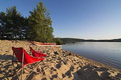 making more memories (Barbara A. White) Tags: algonquinpark achraybeach september grandlake sand kayaks redchairs canada