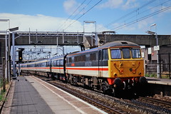 86208 City of Chester at Bescot (Andrew Edkins) Tags: 86208 cityofchester intercity acelectric electriclocomotive bescot sun passenger walsall westmidlands railwayphotography clouds oldphotograph image railwaystation geotagged mainline signal light 1990s class86 platform speed nameplate commuter trip travel