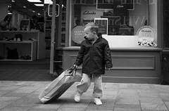 2016_267 (Chilanga Cement) Tags: fuji fujix100t x100t xseries x100s x100 bw blackandwhite shopping shop kid child bag pavement sidewalk clarks shoes ormskirk