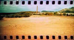 Superior industry (kevin dooley) Tags: lomographysprocketrocket sprocketrocket sprockets lomo film panorama pan crossprocessed xpro az arizona superior
