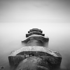 Tranquility (Shahrulnizam KS) Tags: ocean longexposure travel urban cloud white holiday seascape art abandoned beach water monochrome modern rural way concrete photography amazing nikon asia silent slow jetty fineart extreme great tranquility millenium simplicity malaysia slowshutter balance incredible milky minimalist tranquil bnw silky lansdscape sewers portdickson cropsquare nd400 d90 malaysianphotographer lookingforward leadingline shahrulnizamks