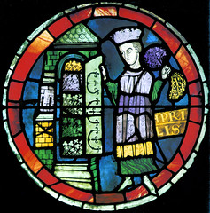 April - A man - wearing a toque - holding flowers and opening the door to his garden (petrus.agricola) Tags: window glass rose de cathedral south des lausanne notredame stained cathdrale months mois dei travaux ciclo labors mesi lanne monatsarbeiten