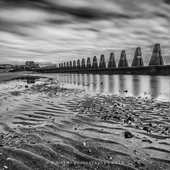 Cramond Pillars (Wan ~stuck in catch up loop) Tags: longexposure blackandwhite shells reflection scotland sand squareformat pillars eastlothian cramondisland sep2 nikond300 sigma1020mmdchsm wmekwiphotography mekwicom