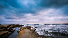 La Jolla Blues (Justin in SD) Tags: ocean california blue sunset beach water rock canon coast rocks waves pacific sandiego wave lajolla coasta
