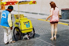 Untitled (ErnestDuffoo) Tags: street dog color slr film peru lady 35mm kodak sombra perro shade icecream leash canonae1program helado nestle calor portra400 closetoyou muter cercadeti peru sanafria republicadelperu