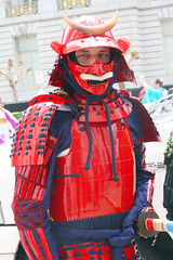 Red Samurai (shaire productions) Tags: sf sanfrancisco street red people urban streets asian photography japanese photo costume image candid traditional helmet picture culture pic celebration event photograph armor gathering warrior metropolis samurai annual moment popculture decor armour cultural imagery cherryblossomfestival cherryblossomparade cherryblossomevent