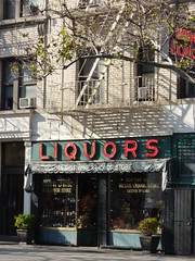Liquor Store Greenwich Village New York (Belinda Fewings (3 million views. Thank You)) Tags: street city newyorkcity red people usa newyork color building green architecture buildings reflections colours flat few colourful liquors liquorstore greenwichvillage usaunitedstatesofamerica panasoniclumixdmc fewings pbwa inspireaholidayortrip notskyscrapersbutatraditionalliquorstoreingreenwichvillagenewyork