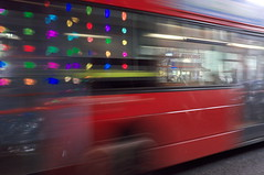 Bubble wrap lighting and bus (Gary Kinsman) Tags: lighting bridge red motion reflection bus london movement motionblur borough southwark se1 southwarkstreet fujifilmfinepixx100 bubblewraplighting