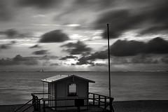 Drifting away (markus.homann) Tags: westerland northsea sylt blackwhite sky baywatch sunset nikkor50mm18ai nikond700 beach ocean seascape sea