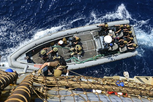 USS Whidbey Island conducts small boat operations.
