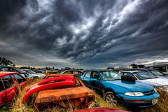 Incoming (grantg59@xtra.co.nz) Tags: junk yard clouds dramatic sky amazing atmosphere mammatus hdr exposed wreck abandoned forgotten