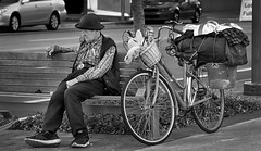 Lost in Thought (Inge Vautrin Photography) Tags: man person people bench city streetphotography street sitting bike bicycle hat monochrome blackandwhite bw thought thinking outside outdoors
