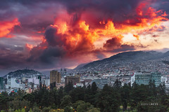 Fire Over Quito (glness) Tags: quito ecuador andes sunset rainyseason equator andesmountains fiery gregness city southamerica mountains fireinthesky capital unesco worldculturalheritagesite cloud clouds sky