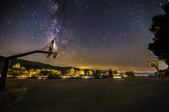 Selfshot in the basketball court under the Milky Way (Vagelis Pikoulas) Tags: stars star universe space galaxy milky milkyway way long exposure night nightscape landscape selfshot selfie myself view sky porto germeno greece europe september 2016 autumn light lights lightroom man basket basketball court mountains mountain mount canon 6d tokina 1628mm full fullframe frame