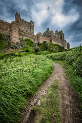 Bamburgh Castle (Daniel Zwierzchowski) Tags: canon t2i rebel 1022mm eos550d 550d eos castle bamburgh clouds outdoor architecture architektura england uk mountain rock path grass hill landscape