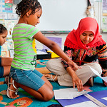 Maryam Khan, class of 2013, works with second grade students at Wiley International Studies Magnet Elementary School.