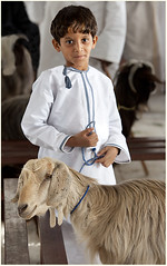 """ A Boy And His Goat"" (flavius200) Tags: nature boys nikon desert wildlife muslim dcc traditional religion uae middleeast culture goat trading arabia winner souk sur rps tradition oman landcruiser wadi souq nizwa bedu herder tribesman hajar tribesmen omani ibri herdsman masirah rustaq jabelshams wadibaniauf nikond3x wadisultan dorkingcameraclub flavius200 davidharfordlrps selsdoncameraclub davidharford"