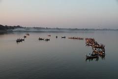 Boats lined up for Sunset (Travel Aficionado) Tags: bridge boats boot boat burma boote myanmar brücke birma amarapura ubeinbridge ubeinbrücke