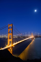Golden Moon (Dan Chui (on/off!)) Tags: sanfrancisco california ca travel sea sky urban cliff usa moon mountain cars water fog skyline architecture modern night america buildings landscape geotagged boats lights evening bay us nikon glow cityscape traffic famous citylife tranquility landmark goldengatebridge transportation baybridge embarcadero 24mm majestic discovery sausalito suspensionbridge development metropolitan connection scenics d800 highangle