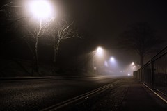Backstreet (perks to working nightshifts) [Explored] (hobbers1973) Tags: road uk trees shadow england mist colour fog night sussex mono coast streetlight mood darkness pavement backstreet explore carbon shoreham explored heliconfilter