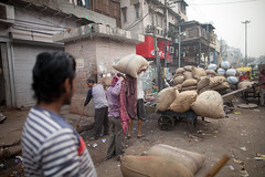 Indian porters in New Delhi (BDphoto1) Tags: morning india color men fruits horizontal trash workers delhi indian nuts streetphotography streetlife photograph transportation filth ethnic carts cultural newdelhi sweeping lifting sacks poters ediorial