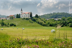 SEVNICA CHURCH ON THE HILL (SLOVENIA, SEVNICA) (KAROLOS TRIVIZAS) Tags: flowers houses plants church field grass clouds hill harvest rick straw chapel slovenia hay herb slope cultivation sevnica digitalcameraclub hayrick blinkagain reapingmowing