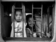 R (streetwrk.com) Tags: street travel people bw india monochrome kids train blackwhite streetphotography stranger trainstation bombay mumbai socialdocumentary streetogs streetwrk