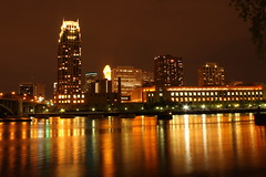 Skyline from Nicollet Island (jfpalmer) Tags: city windows orange reflection building tower water minnesota skyline night skyscraper buildings river lights downtown traffic dramatic minneapolis riverfront twincities carlyle nicolletisland minneapolisskyline