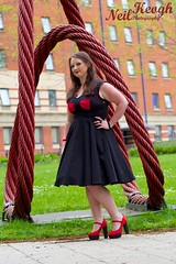 IMG_4478 (Neil Canon Keogh) Tags: red black vintage necklace highheels dress retro ring redhead bow buskers bracelet heels rockband pinup pinupgirl trianglesquare manchestercitycenter dressmodellaura