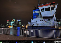 A Slice Of Reality (andrewtijou) Tags: uk longexposure light england london water thames night reflections river dark boat nikon greenwich slice wharf reality tug canary a of d5000 andrewtijou