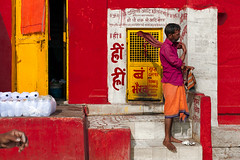 Street. Varanasi, India (Marji Lang Photography) Tags: benares canonef50mm12l canoneos5dmii india indian indianman marjilang marjilangphotography uttarpradesh varanasi colorful colors composition daylight dhoti donationbox door geometry hand horizontal man motion movement oneperson people red street streetcomposition streetphotography streetshot temple travel yellow ghat ghats dasaswamedhghat outdoor day colourful warm