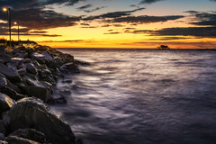 End of the Day (Mat Viv) Tags: canon canon760d canont6s 760d t6s canoneos760d canoneost6s sigma sigma1750mmf28 outdoors sea longexposure wideangle waves water sun sunset sunlight dusk twilight clouds sky horizon fishing travel italy tuscany pisa rocks foam surf view orange blue