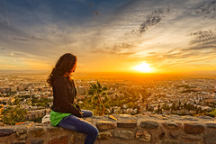 Sending off a wonderful day (Gene Krasko Photography) Tags: sunset sky woman sun girl set female clouds landscape spain skies cityscape watching andalucia espana jeans palmtree alhambra granada brunette andalusia gazing jeanjacket settingsun southernspain nikond700 blinkagain genekraskophotography
