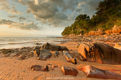 Casting the golden shadows (Louise Denton) Tags: sunset sea beach rocks nt australia darwin lastlight goldenlight mindilbeach