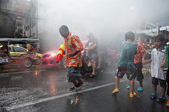 Water fights on Bangkok streets during Thai New Year celebrations in Thailand (Igor Bilic) Tags: road street new urban motion water festival thailand photography fight bangkok year hose celebration motorbike splash blured bkk khaosan songkran squirting