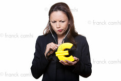 Portrait of beautiful woman examining euro (Franck Camhi) Tags: portrait people woman white money paris france girl female cutout asian person one 1 holding control euro background domination listeningto expressions medical indoors mature worried expressive worry studioshot savings doubt conceptual economic emotions financial sullen stressed economy crisis indonesian stethoscope anxiety oneperson annoyed finance anxious concepts moneybox annoyance negativity examining sulk hesitation expressing hesitancy onewoman