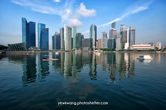 Singapore City Skyline 01 (yewkwangphoto) Tags: sea cloud seascape tourism water horizontal architecture landscape singapore asia cityscape bluesky tourist hotels banks skyscaper famouslandmark commercialbuilding placeofinterest modernbuildings modernstructure buildingstructure singaporecityskyline photocategory yewkwang photographybyyewkwang