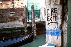 Venice safety plan (zarpluca) Tags: venice gondola bookshop acquaalta canale fireexit libreria emergenza uscita sigma30mmf14