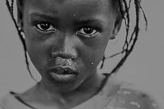 il peso di uno sguardo (mat56.) Tags: portrait white black monochrome face look portraits monocromo eyes village child occhi sguardo senegal ritratti bianco ritratto nero viso bimba bambina villaggio sipo mat56