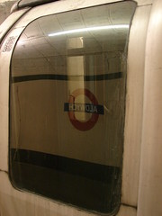 Back To Aldwych (mdavidford) Tags: door reflection abandoned window station sign strand train circle underground mirror transport tube platform gap aldwych reverse roundel edwardjohnston charlesholden